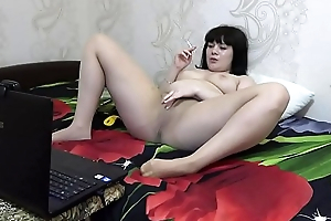 A brunette on a webcam in Skype communicates adjacent to a band together fetishist, she smokes and masturbates in nylon pantyhose.