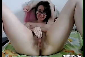 Ugly brunette with hairy bush pussy uses toy to orgasm