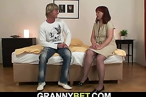 Hot 60 years old grandma in stockings rides his cock