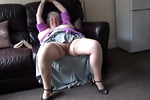 Mature granny with massive tits and hairy herb stripping and teasing